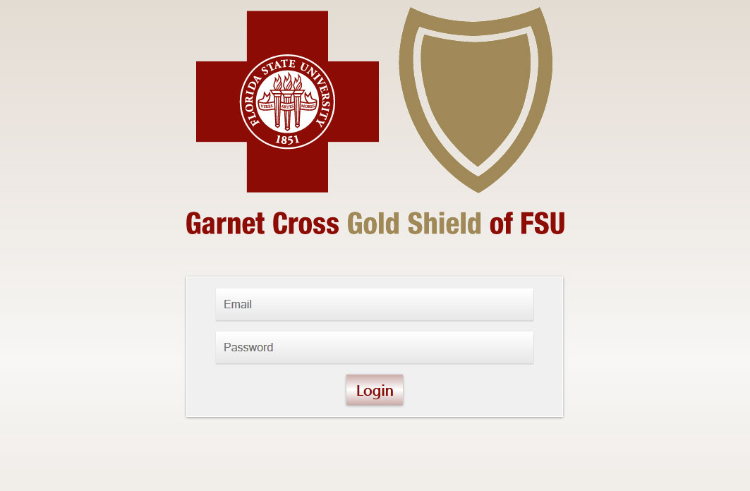 Garnet Cross Gold Shield